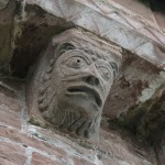 man-beast corbel on the east apse exterior