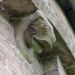 Dolphin corbel on east apse exterior